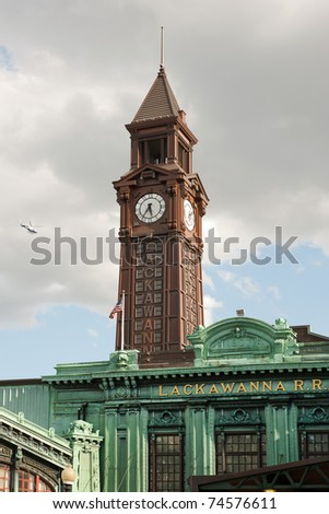 Warrington Plaza and clock tower of Hoboken terminal building - stock photo