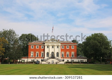WARRINGTON, UK - AUGUST 23, 2015: Warrington Town Hall, Cheshire, England. The Town Hall, flanked by two detached service wings at right angles to the house, is a Grade I listed building - stock photo