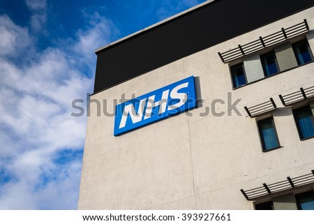 WARRINGTON, UK - MARCH 6, 2016: View of the NHS (National Health Service)  logo at the Springfields Medical Centre in the centre of Warrington, Cheshire. - stock photo