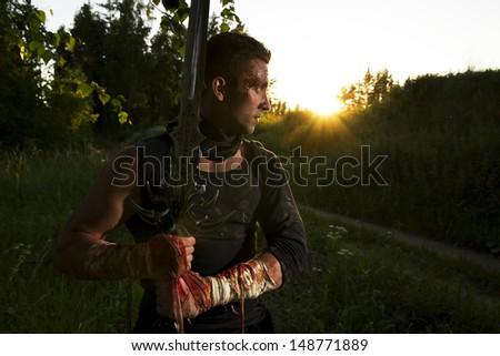 warrior and sunset - stock photo