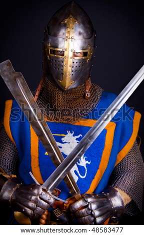 Warrior holding his weapons in hands - stock photo