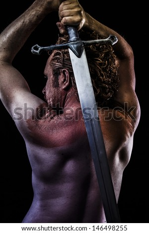 Warrior with big sword, muscular back - stock photo