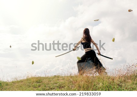 Warrior woman on the top of the hill. - stock photo