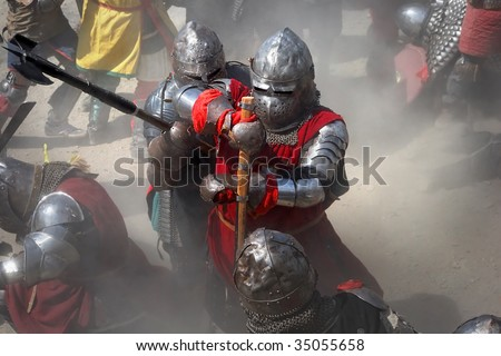 Warriors at battlefield - stock photo