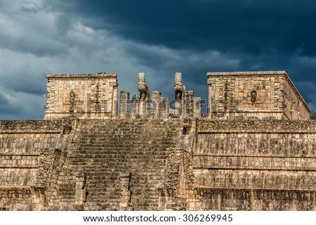 Warriors Temple (los Guerreros). Chichen Itza, Yucatan, Mexico. Temple of the Warriors (Templo de los Guerreros). Chichen Itza archaeological site, Yucatan peninsula, Mexico. - stock photo