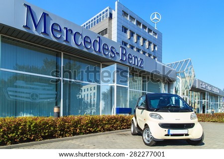 WARSAW- APRIL 1: A Smart car next to Mercedes Benz Centre in Warsaw on April 1, 2015. Smart is the most popular small car in Europe - stock photo
