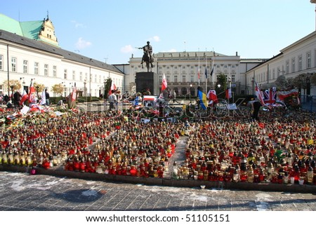 WARSAW - APRIL 15: In many places in Poland burning candles in memory of deceased victims of a tragic plane crash. Presidential Palace. April 15, 2010 in Warsaw, Poland. - stock photo