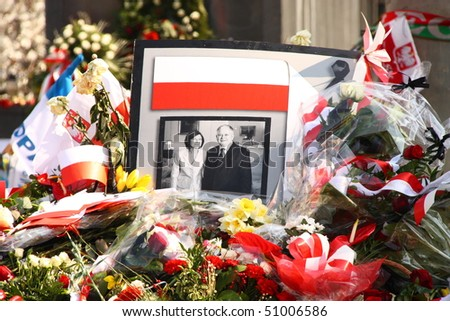 WARSAW - APRIL 15: Poland mourns the victims of a plane crash near Smolensk in which the Polish president Lech Kaczynski was killed with his wife Maria Kaczynska. April 15, 2010 in Warsaw, Poland. - stock photo