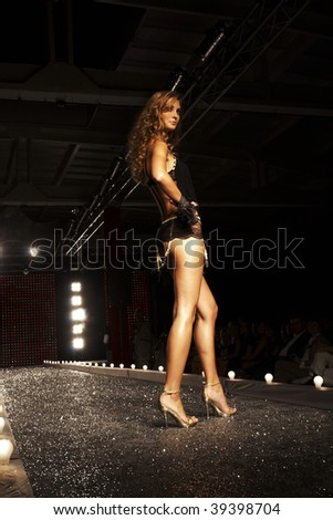 WARSAW - AUGUST 2007:  A model walks the runway at the New Face Agency  Fashion Show on August 27, 2007 in Warsaw, Poland. - stock photo