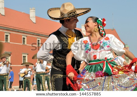 """WARSAW - AUGUST 27: Dancers of folklore ensemble """"VALLARTA AZTECA"""" from  Mexico - street parade during the International Folklore Festival """"WARSFOLK&quot ; ; on August 27, 2011 in Warsaw, Poland.   - stock photo"""