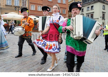 WARSAW - AUGUST 25: Folklore ensemble ROSSIJANA from Russia - street parade during the International Folklore Festival WARSFOLK on August 25, 2011 in Warsaw, Poland. - stock photo