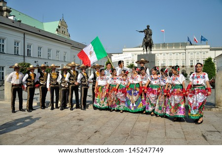 WARSAW - AUGUST 27: Folklore ensemble VALLARTA AZTECA (Mexico) in front of presidential palace - street parade during the International Folklore Festival WARSFOLK on August 27, 2011 in Warsaw, Poland. - stock photo