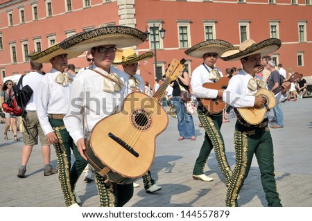 "WARSAW - AUGUST 27:  Mariachi band ""VALLARTA AZTECA"" from - Mexico, play mexican music - street parade during the International Folklore Festival ""WARSFOLK"" ; on August 27, 2011 in Warsaw, Poland. - stock photo"