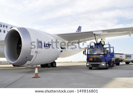 WARSAW - AUGUST 4: New Boeing 787 Dreamliner of the LOT Polish Airlines - receiving fuel from tanker truck at Chopin Airport on August 4, 2013 in Warsaw, Poland.  - stock photo