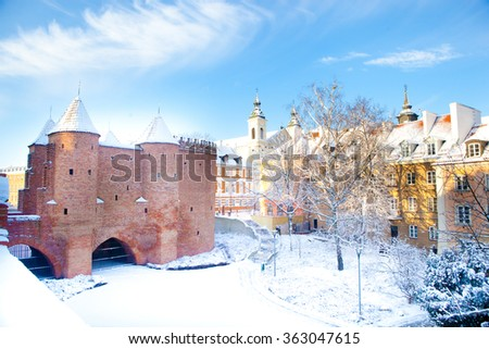 Warsaw Barbacan fortress (castle) in winter is in the capital city of Poland. Old town is the historic center of Warsaw. Sights of Poland. Snow day. Winter, travel (vacation), architecture concept.   - stock photo