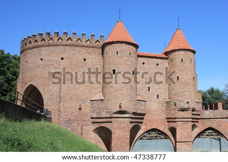 Warsaw: Barbican medieval city wall, forming part of the unesco world heritage center - stock photo