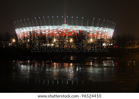 WARSAW - FEBRUARY 29: Illumination of the facade National Stadium in Warsaw  on February 29, 2012 in Warsaw, Poland. At this stadium will be the opening match of Euro 2012. - stock photo