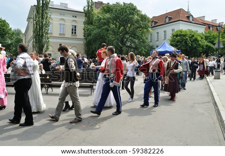WARSAW - MAY 30: Dance parade in the courtyard of the University of Warsaw on the occasion of the 200th anniversary of the birth of Fryderyk Chopin. MAY 30, 2010 in Warsaw, Poland. - stock photo