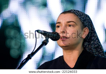 WARSAW - MAY 31: Irish singer Sinead O'Connor during the City Culture Zone festival. Square in front of the Palace of Culture and Science. May 31, 2008 in Warsaw, Poland. - stock photo