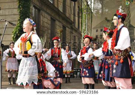 "WARSAW - MAY 30: Krakowiak dance performed by Song and Dance Ensemble ""Male Podlasie"" - on the occasion of the 200th anniversary of the birth of Fryderyk Chopin. MAY 30, 2010 in Warsaw, Poland. - stock photo"