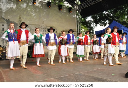 "WARSAW - MAY 30: Zywieckie dances performed by Folk Dance Ensemble ""Promyki"" - on the occasion of the 200th anniversary of the birth of Fryderyk Chopin. MAY 30, 2010 in Warsaw, Poland. - stock photo"