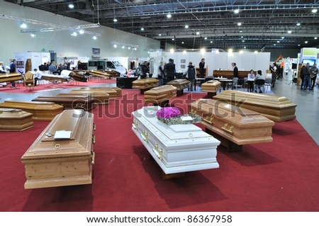 "WARSAW - NOVEMBER 20: Coffins at the exhibition of funeral industry ""V Funeral Fair MEMENTO'2010"" on November 20, 2010 in Warsaw, Poland."