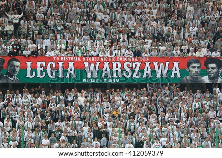 WARSAW, POLAND - APRIL 15, 2016: Legia Warsaw fanatical fans during polish league football match between Legia Warszawa and Lech Poznan in Warsaw.  - stock photo