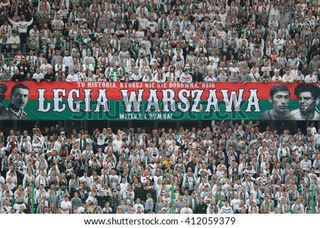 WARSAW, POLAND - APRIL 15, 2016: Legia Warsaw fanatical fans during polish league football match between Legia Warszawa and Lech Poznan in Warsaw.  - stock photo
