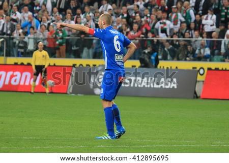 WARSAW, POLAND - APRIL 15, 2016: Lukasz Tralka (Lech Poznan) in action during polish league football match between Legia Warszawa and Lech Poznan in Warsaw.  - stock photo