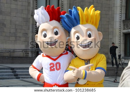 WARSAW, POLAND - APRIL 20: Slavek and Slavko, the UEFA Euro 2012 mascots at the official presentation Henri Delaunay Cup on April 20, 2012 in Warsaw, Poland. - stock photo