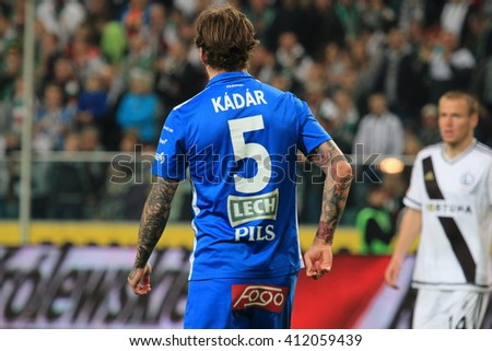 WARSAW, POLAND - APRIL 15, 2016: Tamas Kadar (Lech Poznan) in action during polish league football match between Legia Warszawa and Lech Poznan in Warsaw.  - stock photo