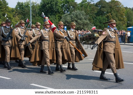 WARSAW, POLAND - AUGUST 15, 2014: Highland Brigade (Podhale Rifles) during the Polish Armed Forces Day. Over 1200 Polish and over 90 foreign soldiers, over 120 military vehicles, more than 50 aircraft - stock photo