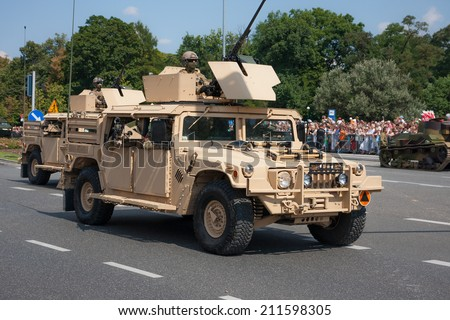 WARSAW, POLAND - AUGUST 15, 2014: Humvee HMMWV light armored vehicle. Polish Armed Forces Day. Over 1200 Polish and over 90 foreign soldiers, over 120 military vehicles, more than 50 aircraft - stock photo