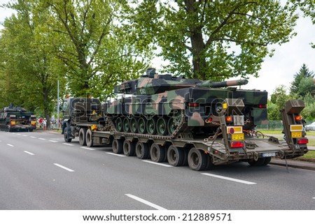 WARSAW, POLAND - AUGUST 15, 2014: Leopard 2 tanks transport convoy. Polish Armed Forces Day. 1200 Polish, over 90 foreign soldiers, over 120 military vehicles and 50 aircraft - stock photo
