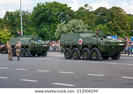 WARSAW, POLAND - AUGUST 15, 2014: Medical Evacuation Vehicles KTO ROSOMAK,  Wolverine. Polish Armed Forces Day. Over 1200 Polish, over 90 foreign soldiers, 120 military vehicles,  50 aircrafts - stock photo