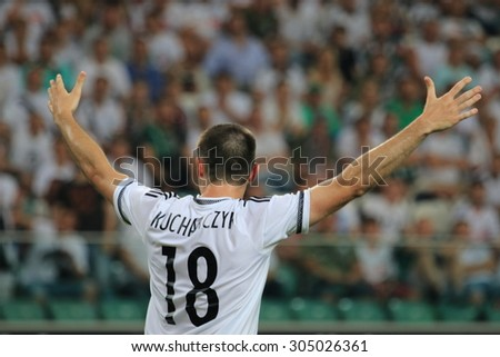 WARSAW, POLAND - AUGUST 06, 2015: Michal Kucharczyk (Legia Warsaw player) during UEFA Europe League football match between Legia Warsaw and FK Kukesi in Warsaw. - stock photo