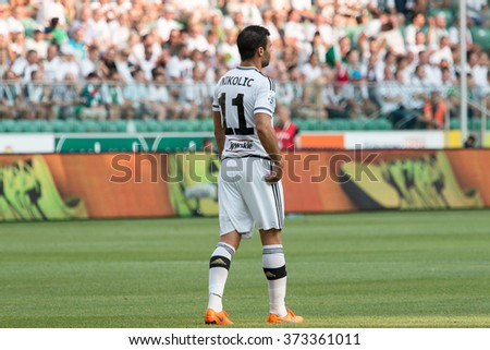 WARSAW, POLAND - AUGUST 09, 2015: Nemanja Nikolic (Legia Warsaw and Hungarian national team striker) during Polish League football match between Legia Warsaw and Wisla Cracow in Warsaw. - stock photo
