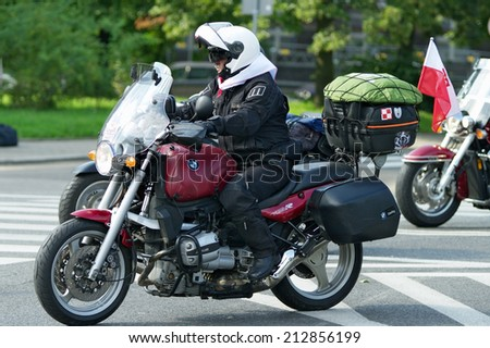 WARSAW, POLAND - AUGUST 23: Participant of 14th Motorcycle Katyn Rally on August 23, 2014 in Warsaw, Poland. The aim of the rally is to pay tribute to 22000 Polish officers killed in 1940 by Soviets.
