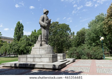 WARSAW, POLAND - AUGUST 05, 2016: Sculpture of the soldier standing at attention who holds in hands a machine gun. It is a Monument to Soldier of the First Polish Army