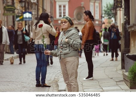 Warsaw,Poland. August 2016. senior woman with rose flower
