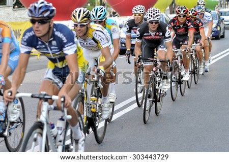"WARSAW, POLAND - AUGUST 1, 2010: The peloton riding through the city streets, during the cycling race ""Tour de Pologne"" - from Sochaczew to Warsaw. - stock photo"