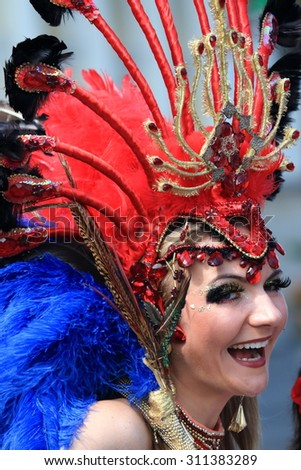 WARSAW, POLAND - AUGUST 30, 2015: Unidentified carnival dancer on the parade on Warsaw Multicultural Street Party. The Multicultural Street Party promotes multiculturalism through joyful celebration. - stock photo