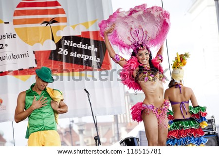 WARSAW, POLAND, AUGUST 26: Unidentified Carnival dancers on the stage on Warsaw Multicultural Street Parade on August 26, 2012 in Warsaw, Poland. - stock photo