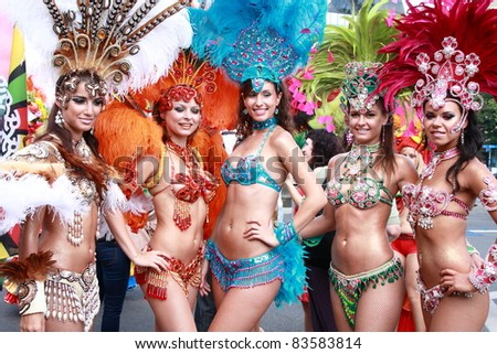 WARSAW, POLAND - AUGUST 28: Unidentified dancers in colorful costumes at the Multicultural Warsaw Street Party on August 28, 2011 in Warsaw, Poland. - stock photo