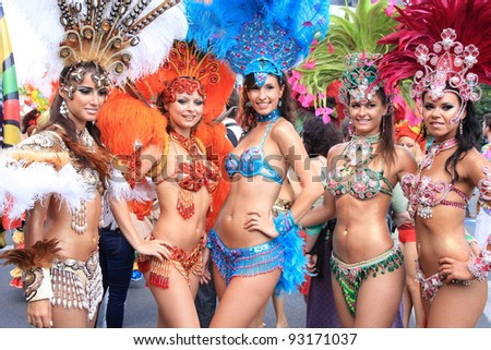 WARSAW, POLAND - AUGUST 28: Unidentified dancers in colorful costumes participate at the Multicultural Warsaw Street Party on August 28, 2011 in Warsaw, Poland. - stock photo