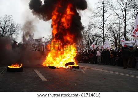 WARSAW, POLAND - DECEMBER 15: Burning tires during anti government Solidarity demonstration on December 15, 2009 in Warsaw, Poland. - stock photo