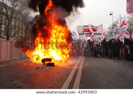 WARSAW, POLAND - DECEMBER 15: Burning tires in the street during anti government Solidarity demonstration on December 15, 2009 in Warsaw, Poland. - stock photo