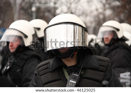 WARSAW, POLAND - DECEMBER 15: Closeup of a police protecting government buildings during anti government Solidarity demonstration on December 15, 2009 in Warsaw, Poland. - stock photo