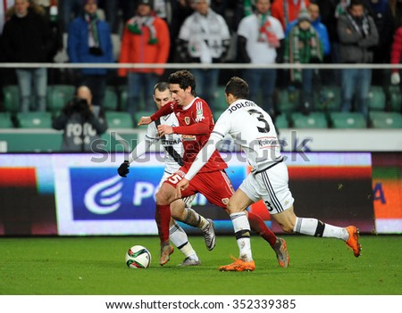WARSAW, POLAND - DECEMBER 13, 2015: T-Mobile Extra League Polish Premier Football League Legia Warsaw Piast Gliwice o/p: Michal Kucharczyk Kamil Vacek Tomasz Jodlowiec