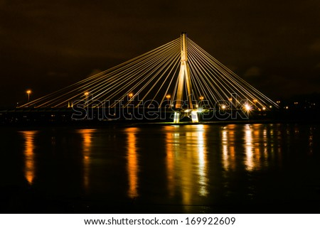 WARSAW, POLAND - DECEMBER 29: The Swietokrzyski Bridge over Vistula river, on December 29, 2013. First modern cable-stayed bridge in Warsaw, 479 m long with the tower 90 m high, opened in October 2000